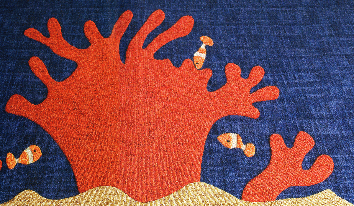 blue ocean and orange coral reef with clown fish custom rug by Niche Graphic Flooring