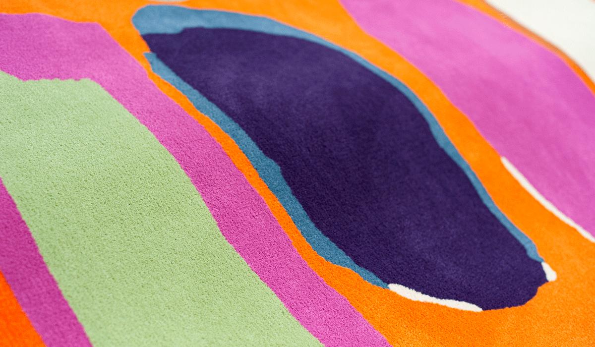 Orange pink green blue and purple custom area rug in Opulence