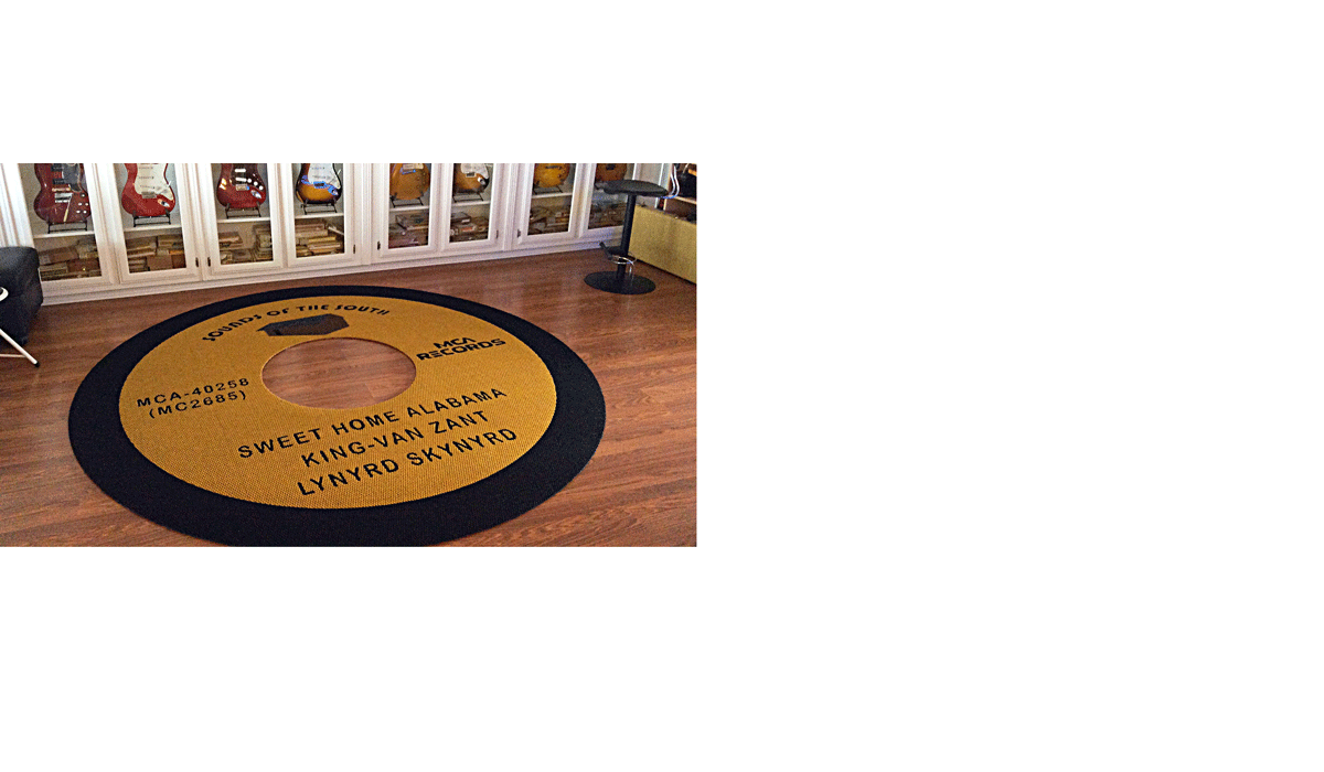 Custom circle black and yellow area rug in the shape or an vinyl record in music room